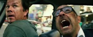 Mark Wahlberg and Stanley Tucci in Transformers: Age of Extinction